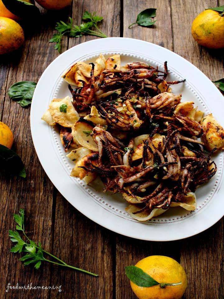 lulas grelhadas com molho de azeite e  mandarina
